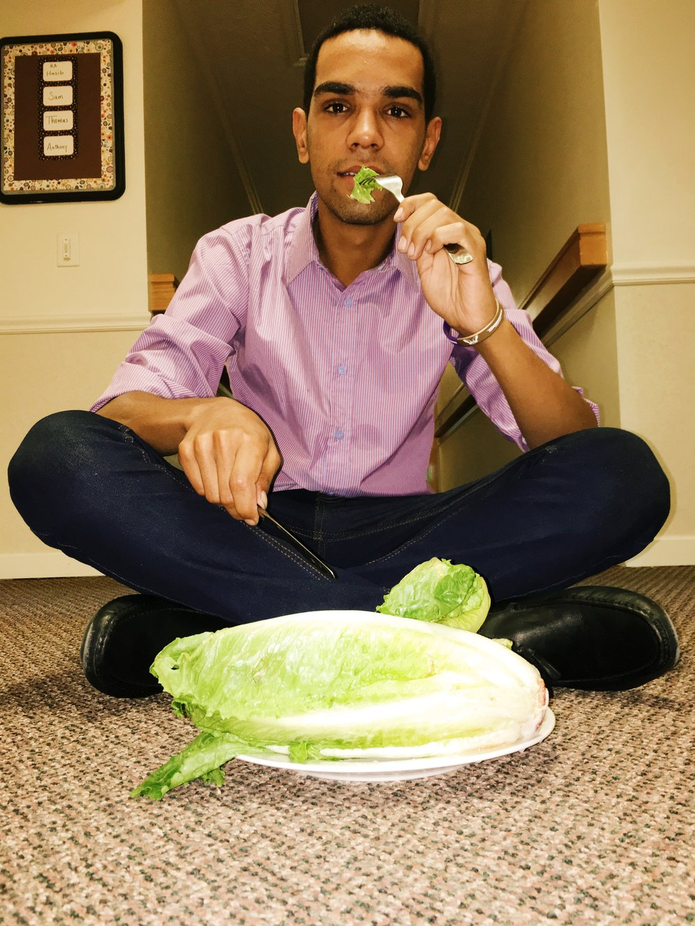 "Munching on a plate of lettuce, first-year international student Muhammad Hassan Rao said he has been eating vegetables and peanut butter for the past few days, since Westminster doesn't offer halal options for Muslim students. ""I feel weak,"" Rao said. Photo credit Hasib Hussainzada."
