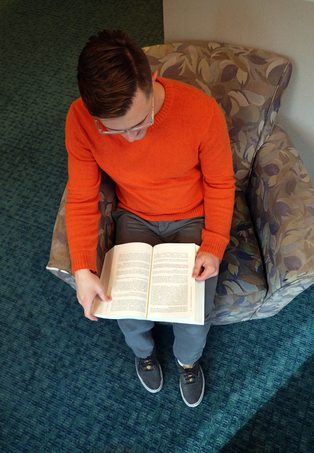 Holden Rasmussen, a junior philosophy major, sits and reads a novel by philosopher Walter Benjamin. Rasmussen said Benjamin has inspired him to research his ideas rather than