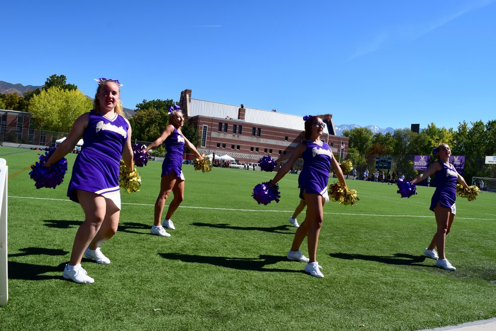 "Westminster's cheerleading team performs for the crowd during a soccer match at Dumke Field on Sept. 25. ""Cheerleaders enjoy the leadership and spotlight, and the dancers tend to appreciate the art of telling the story with only their body, not their voices,"" according to Nicole Vogel, the head coach of Westminster's spirit team. Photo by Scott Salter."