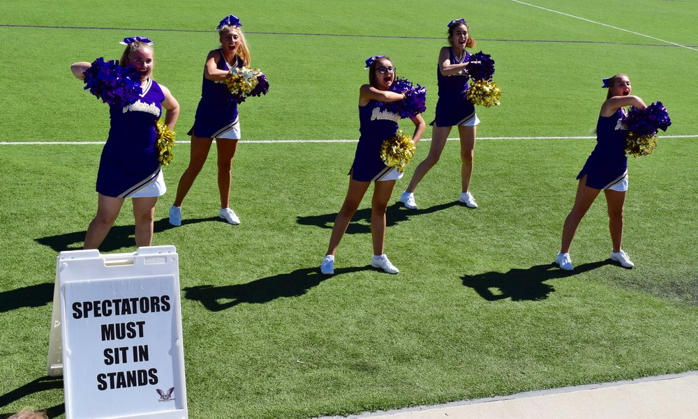 "Westminster's cheerleading team leads cheers during a soccer match at Dumke Field on Sept. 25. ""We want the crowd to get used to the idea of cheering the team on,"" said Hanna Lukes, a Westminster student cheerleader in the graduate program. Photo by Scott Salter."