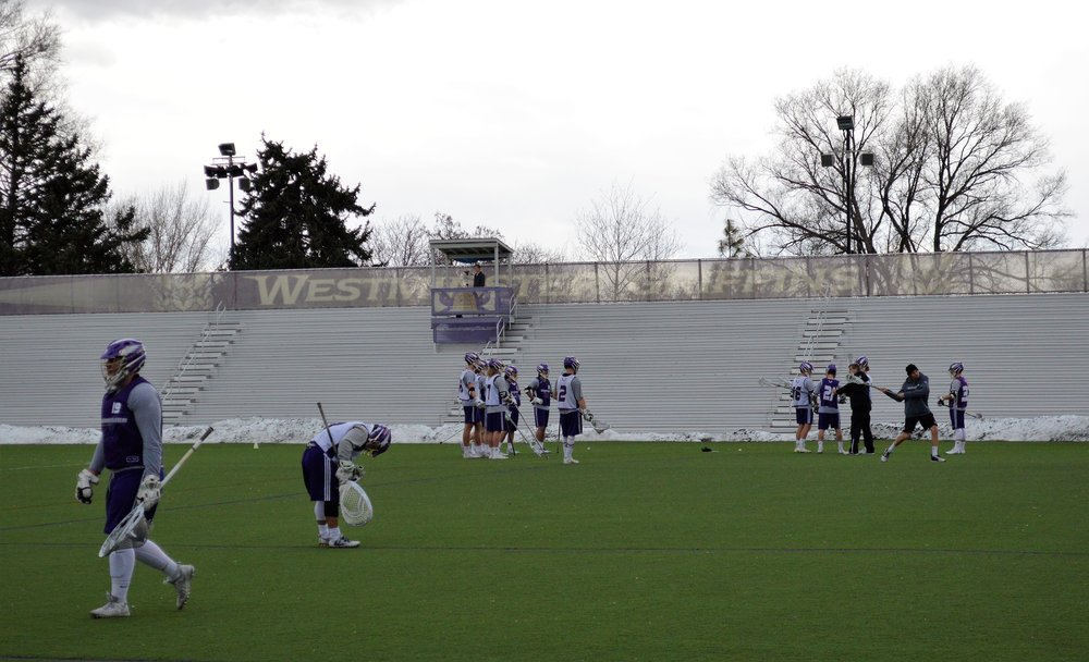 Westminster's men's lacrosse team practices outside on Dumke Field on a clean air day.