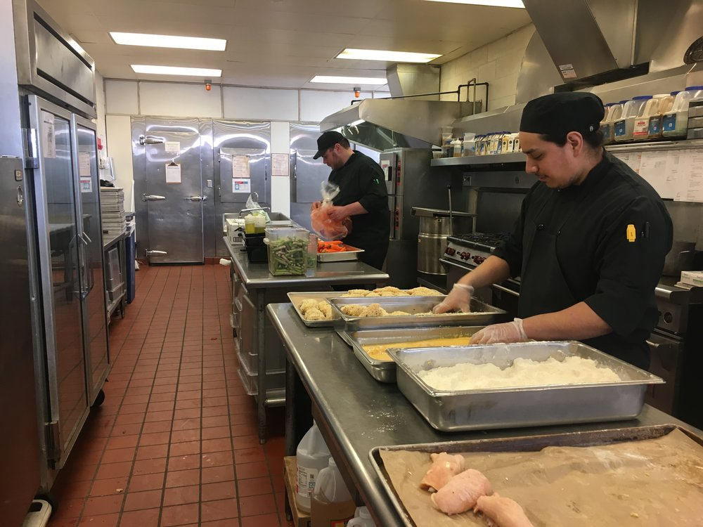 Behind the scenes in the kitchen at the Shaw Student Center, workers at Bon Appétit cook every meal from scratch. Ryan Leonard, general manager of Bon Appétit, said he always challenges his chef to have a vegan alternative. Photo by Casie Peterson.