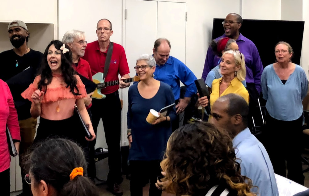 Choir members as they watch clients dance during a performance at YAI in November, 2018.