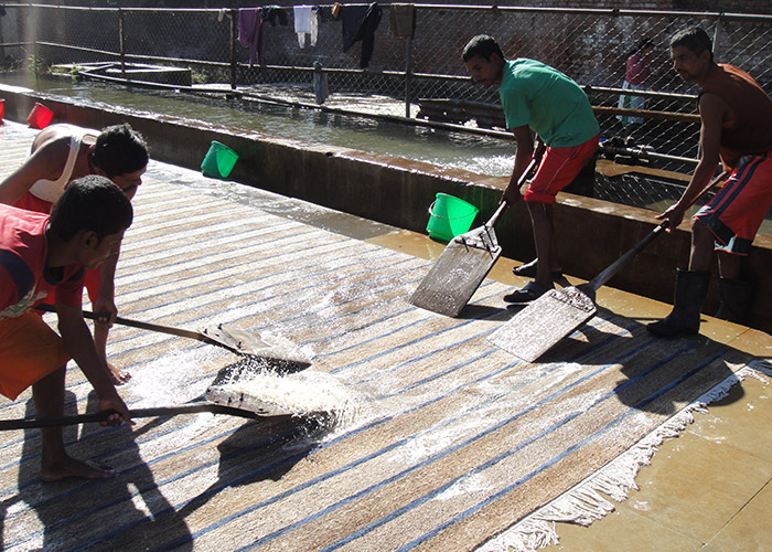 Washing   After the carpet is finished and removed from the loom, it is washed in a cold soap and water mix. We do not apply heavy chemical washes, and all water used is filtered