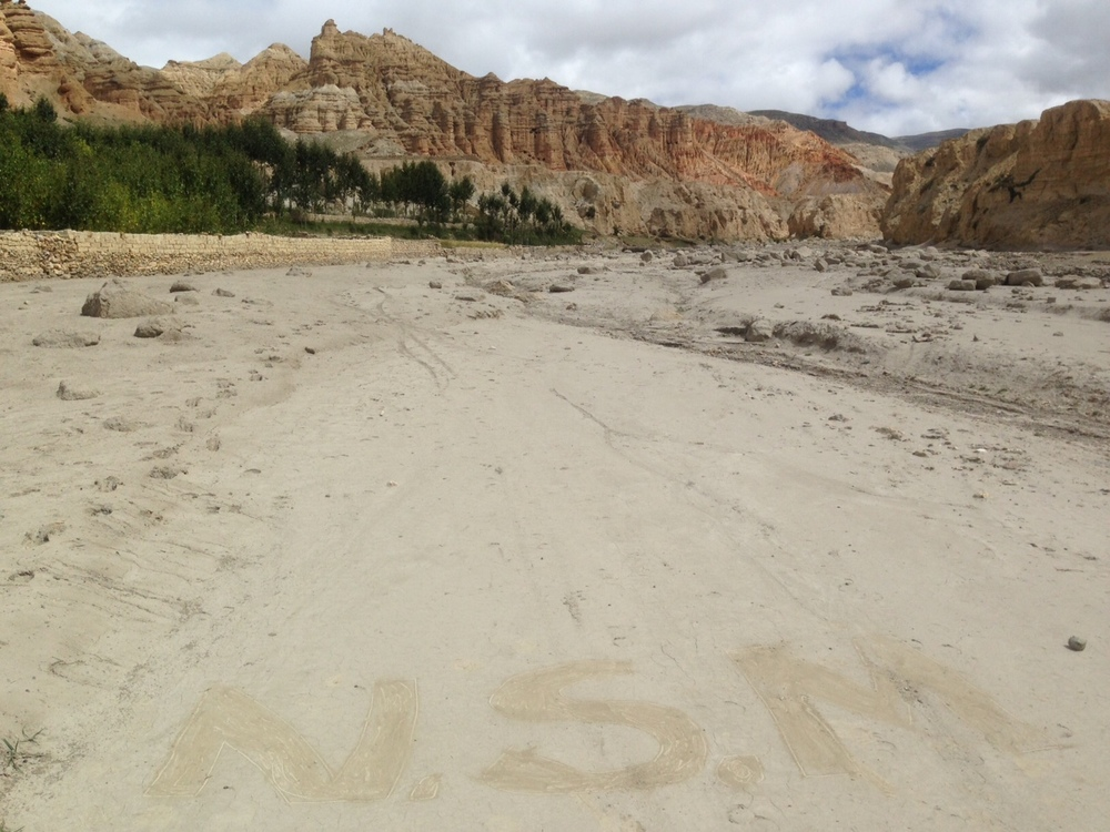 A vast empty road where one of our weavers have written our company initials :)