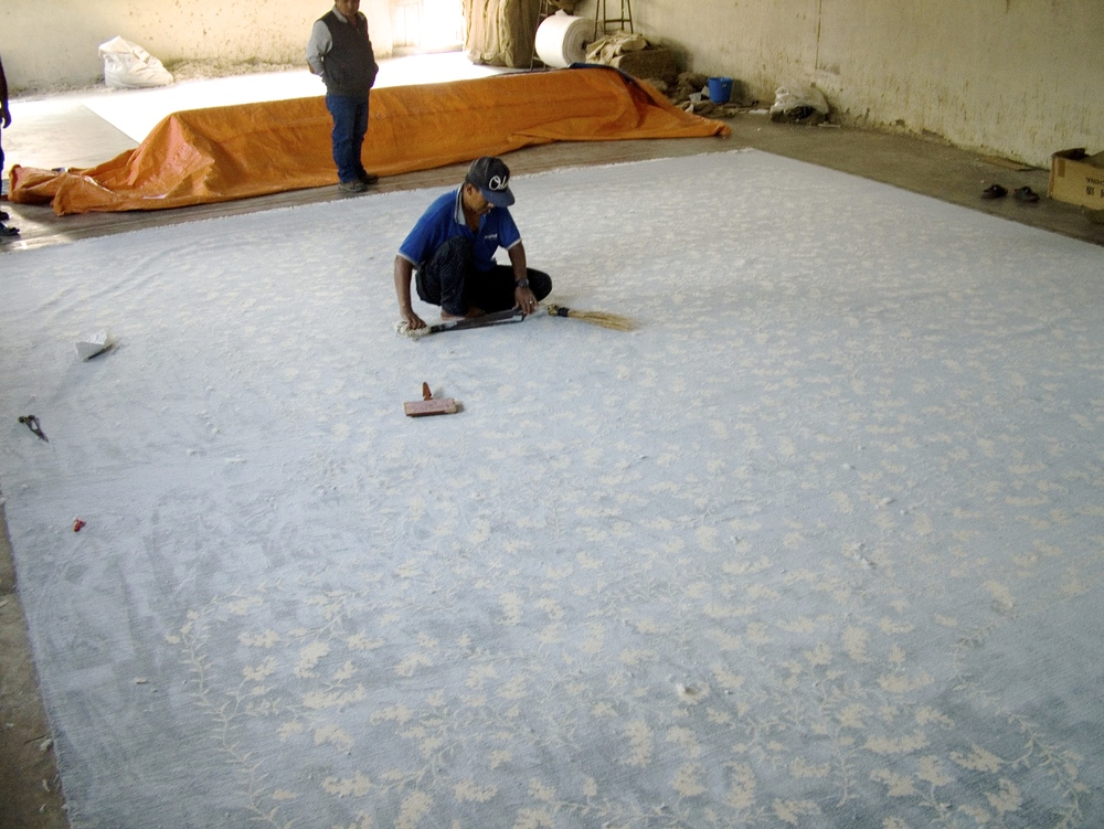 Carpet being hand-carded