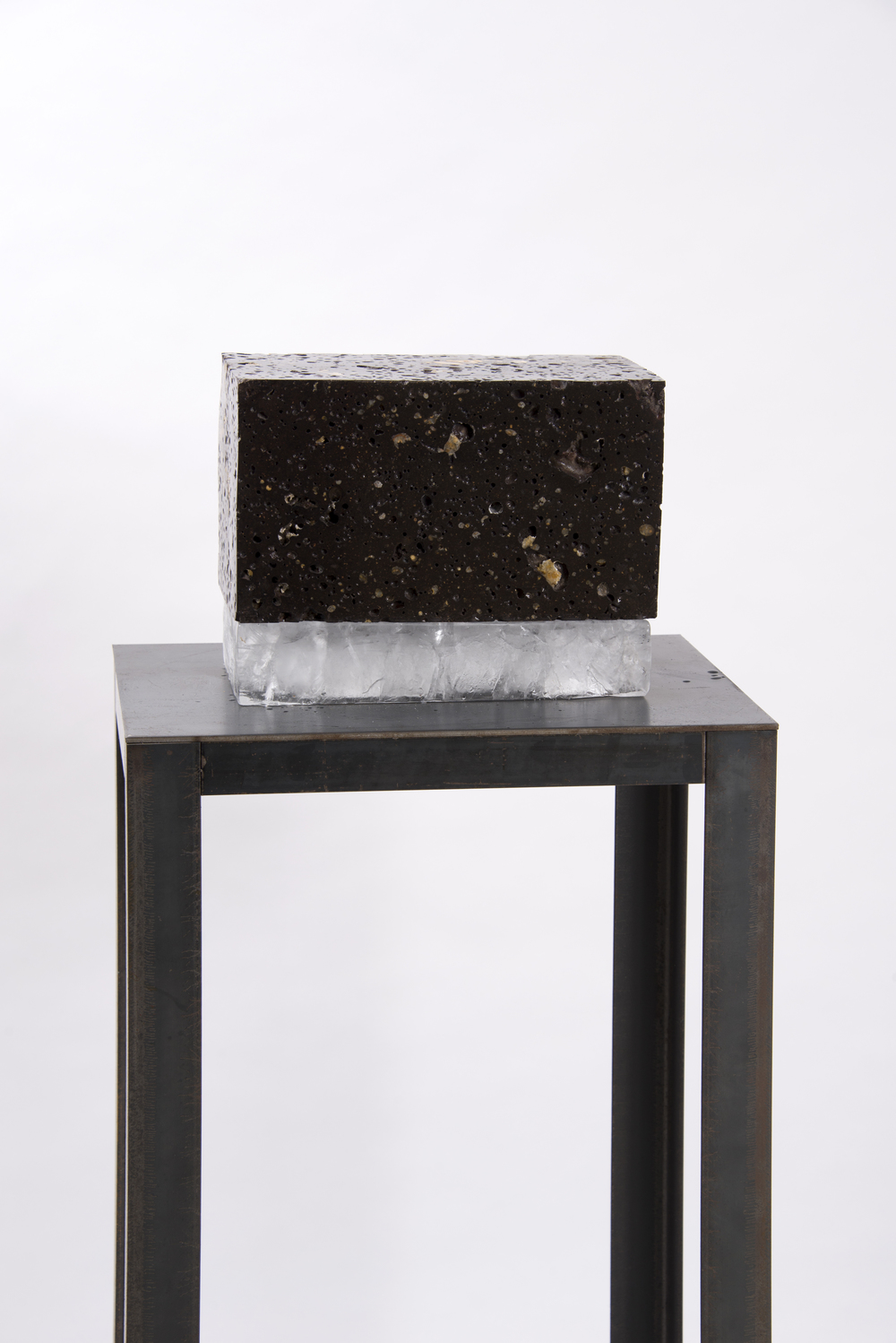'Untitled', (volcanic rock and ice), 23 cm x 30cm x 16cm.     I'm drawn towards the brief relationship of composure the two materials hold, wilst in there very nature untrue.