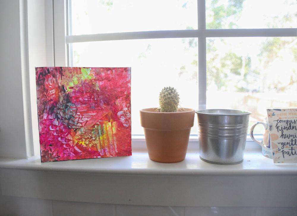 "Emily's piece "" Chrysanthemum"" is on the windowsill"