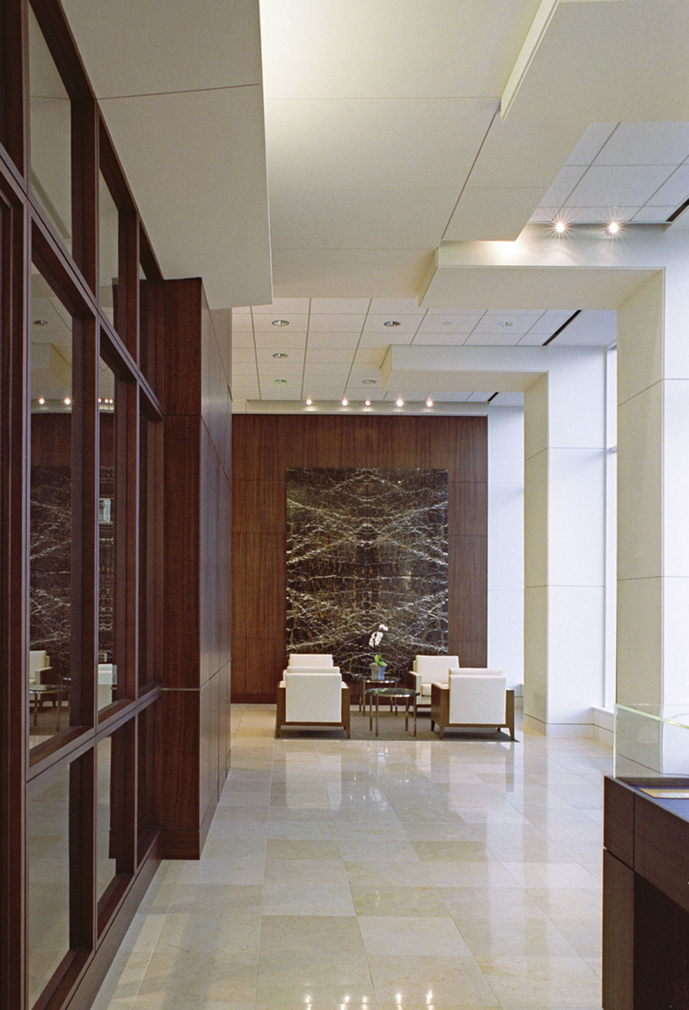 This was a lobby that was designed by a firm I worked with in Houston- that bookmatched granite is stunning!!