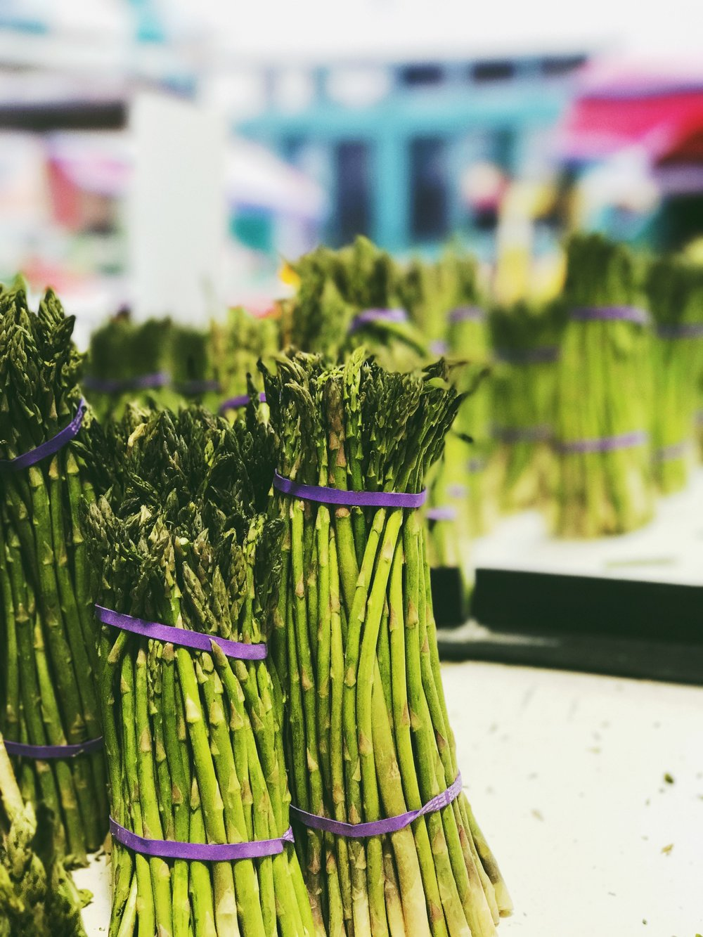 Asparagus at Marché Jean-Talon. Exposure 1/60 at f/2.8. Edited with VSCO.