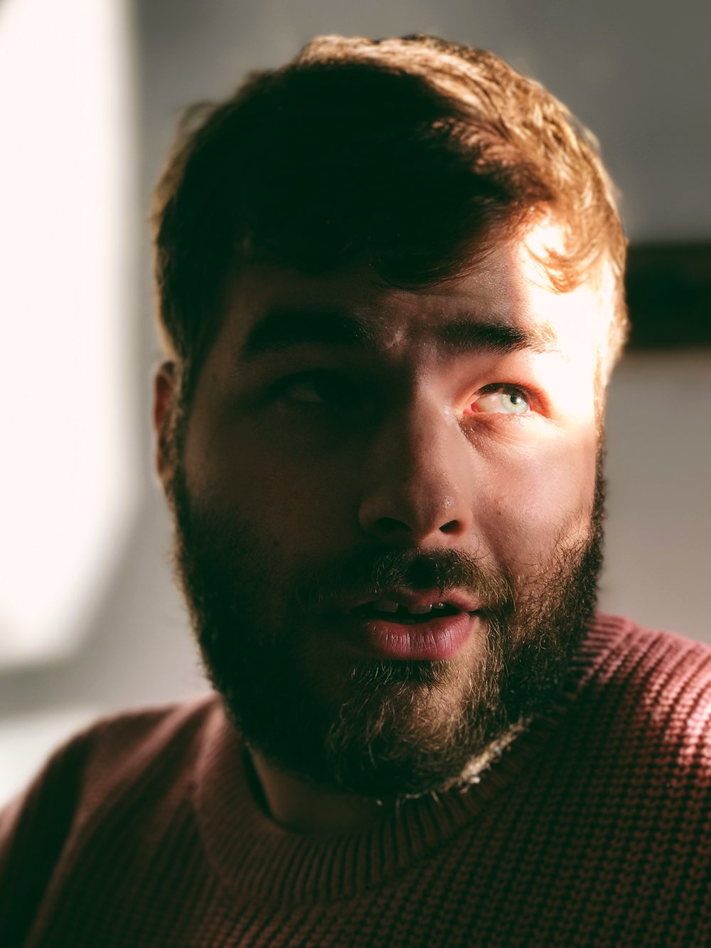 Indoor portrait of my boyfriend with available indoor light. Exposure 1/60 at f/2.8. Edited with VSCO.