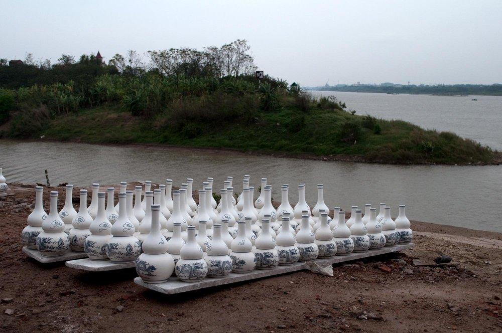 travel-vn-bottles-river.jpg