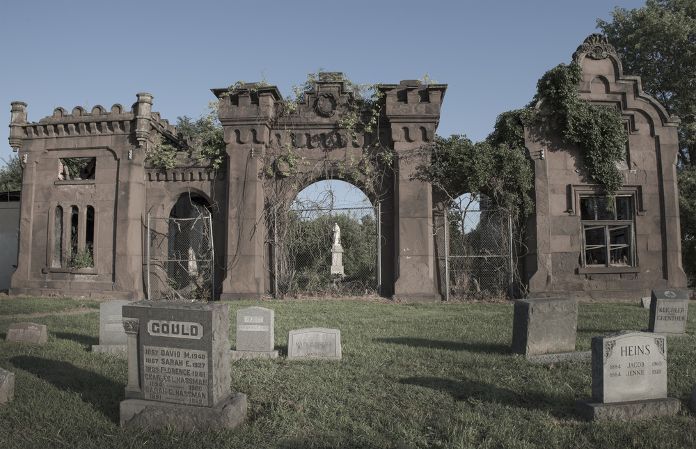 The crumbling entrance to Mount Moriah Cemetery being taken back by nature.