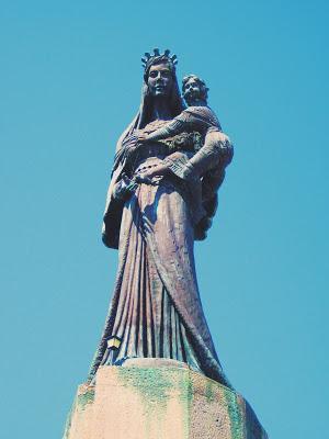 Madonna statue at the top of Church of Santa Maria del Soccorso