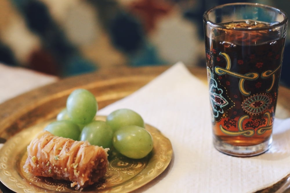 A POST-TREATMENT SERVING OF BAKLAVA AND MOROCCAN MINT TEA.