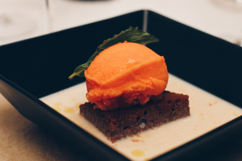 SORBET ON A CHOCOLATE CAKE FLOATING IN CITRUS CREAM