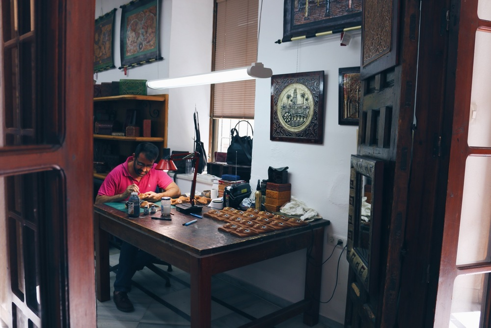 AN ARTIST WORKING AWAY IN THE LEATHER QUARTER