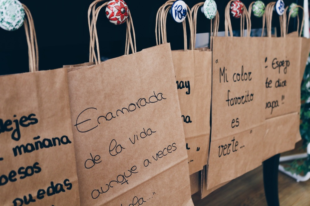 EVERY BAG AT  EL ESPEJO TE DICE GUAPA  CONTAINS A SPECIAL MESSAGE, LIKE: DON'T SAVE TODAY'S KISSES FOR TOMORROW.