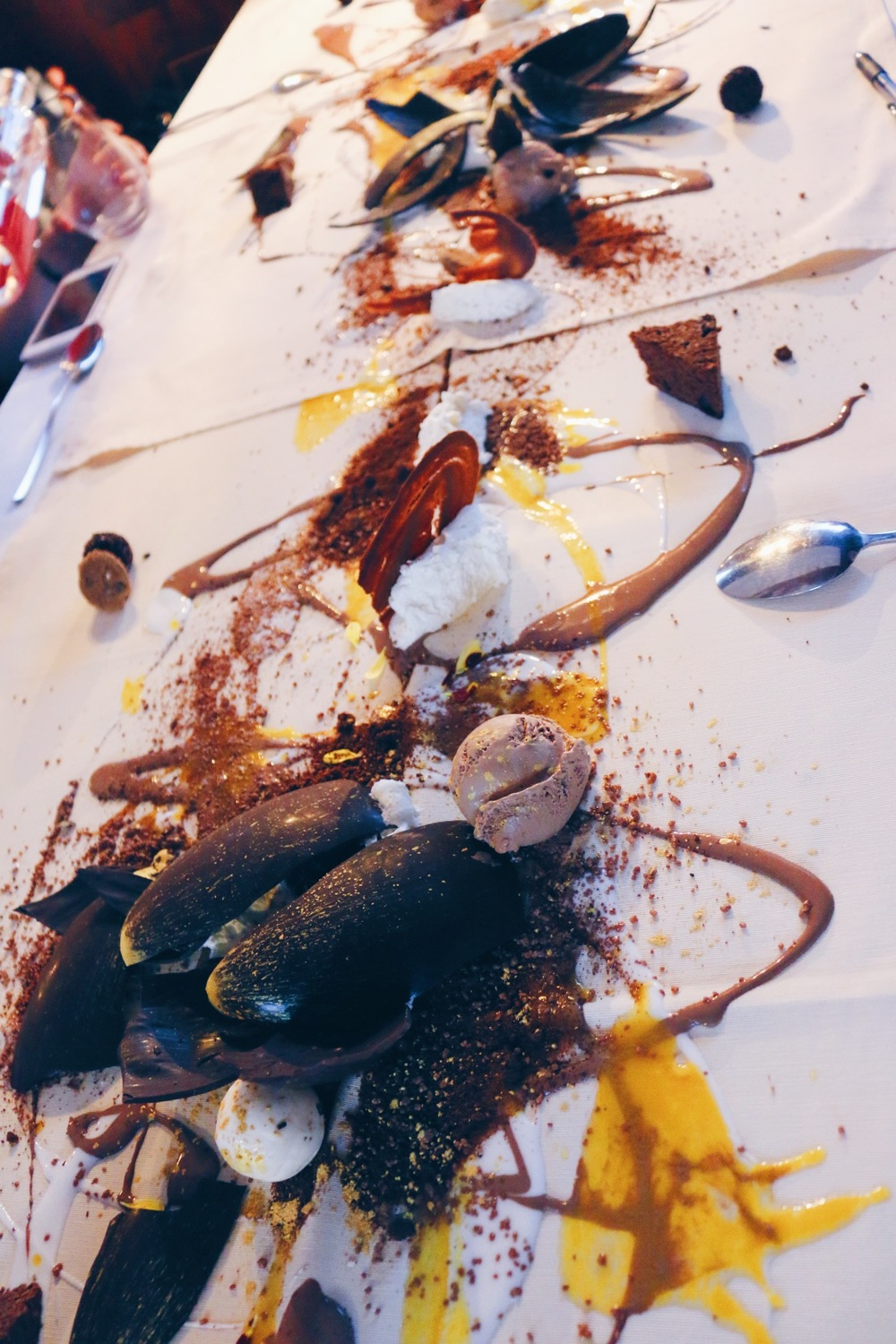 SPECIAL TABLE CLOTHS WERE LAID OUT AND THEN A JACKSON POLLOCK DESSERT CREATION ENSUED (VIDEO BELOW)