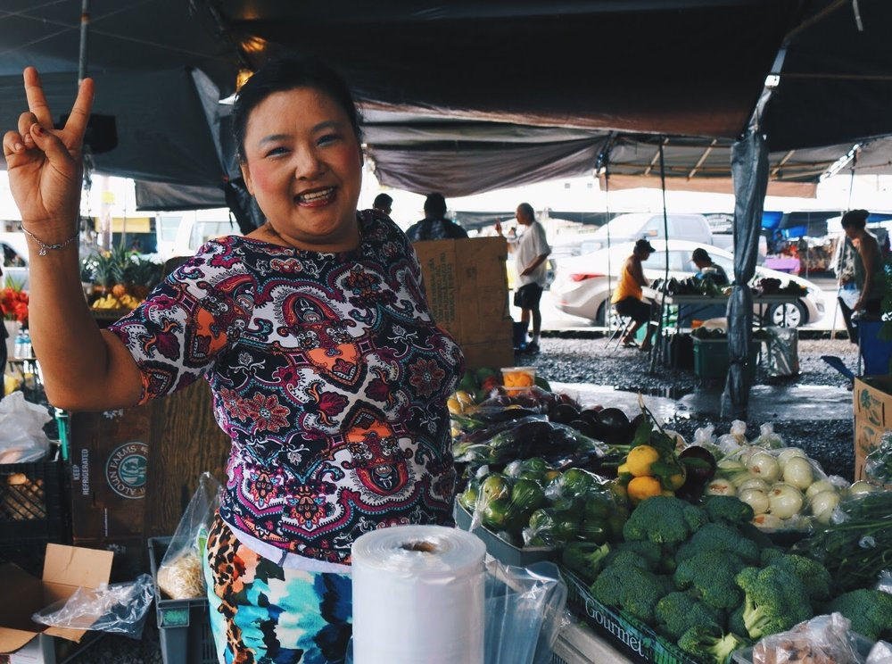 SMILES ABOUND AT HILO FARMERS MARKET.