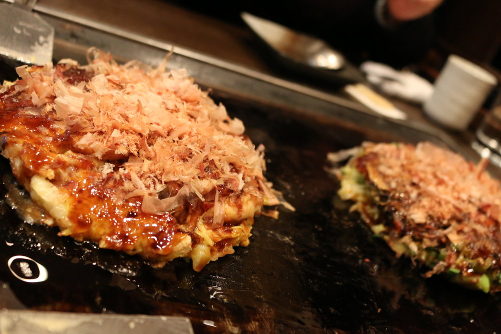 Scallop/mushroom/cheese, and beef tendon/leeks okonomiyaki at  Hozenji San Pei