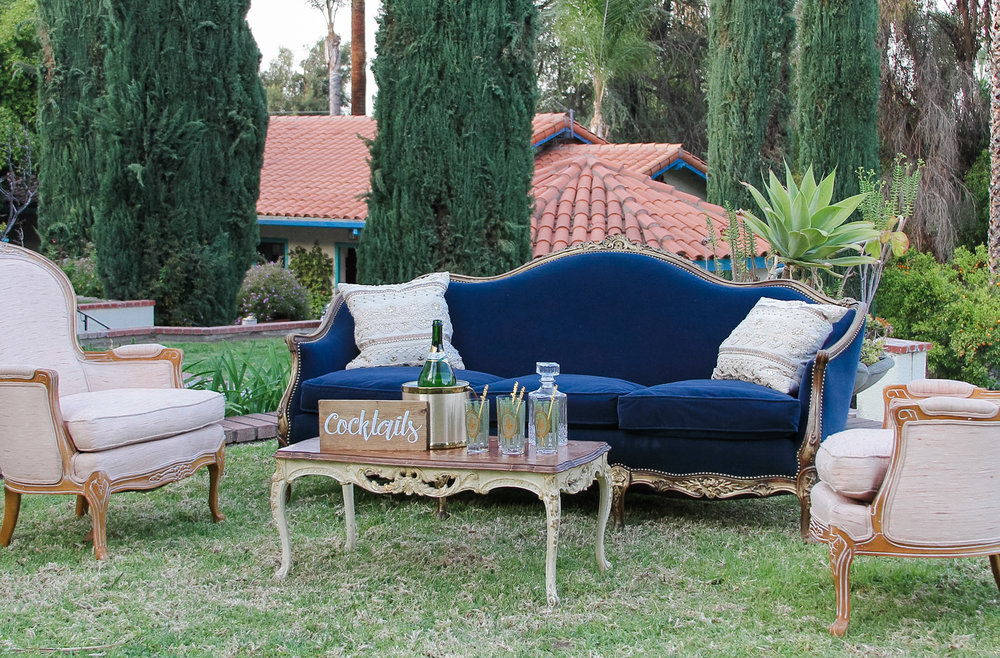 I love this stunning royal blue couch. It really adds so much class to the selected pieces!
