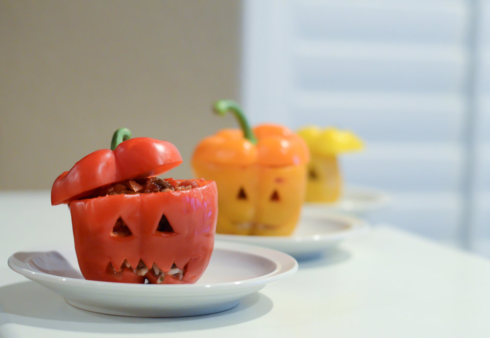 Pumpkin Stuffed Peppers - INGREDIENTS:- 4 medium orange bell peppers- 1 package (8.8 oz) microwavable Spanish style rice- 1 lb ground turkey- 1/2 cup chopped mushrooms & onions (from 8 oz container)- 1 can (8 oz) roasted garlic tomato sauce- 1/4 teaspoon freshly ground pepper