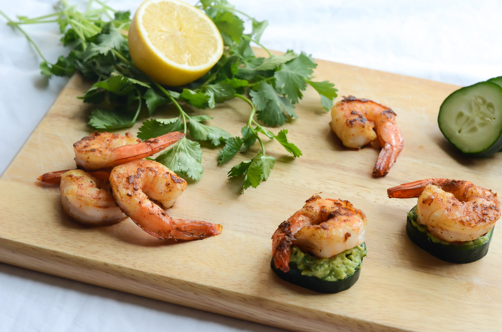 Directions: - Shrimp & Cucumber Bites:Toss the shrimp in the oil and the seasoning and cook in a preheated (medium-high heat) heavy bottomed pan/skillet until slightly blackened, about 2-3 minutes per side.Assemble the bites with cucumber slices, topped with avocado sauce, shrimp and remoulade sauce.Avocado Sauce:Mix everything and enjoy!