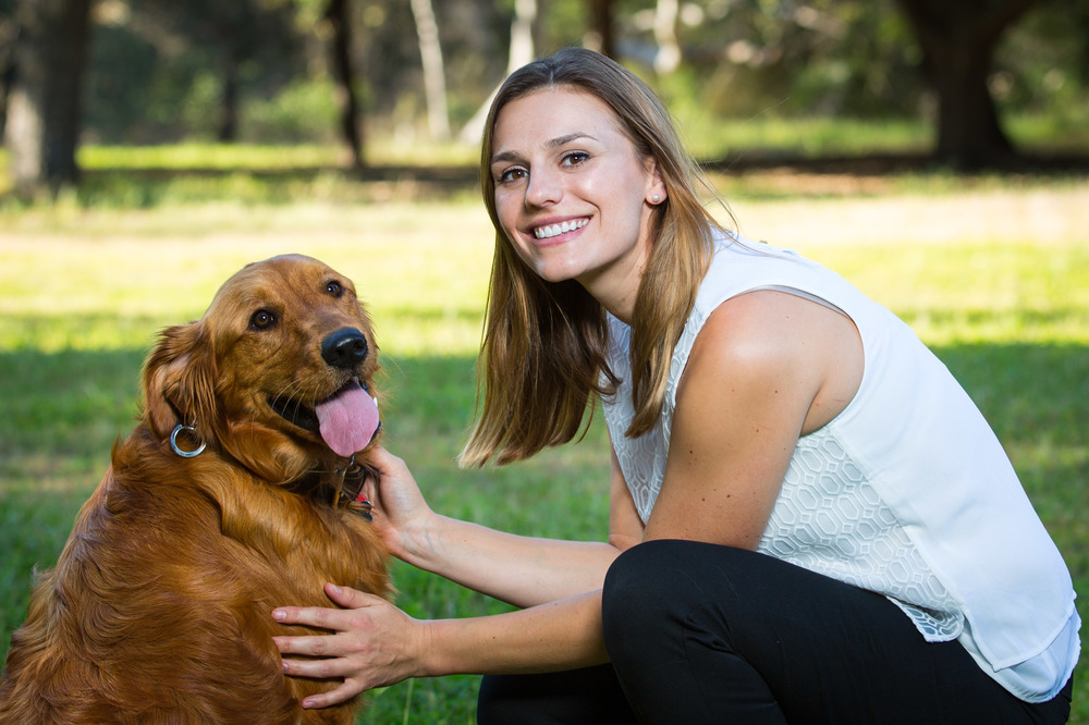Portrait of woman in white blouse with dog, golden retriever dog, in park setting, Lake Anderson Dam Park, Morgan Hill, CA