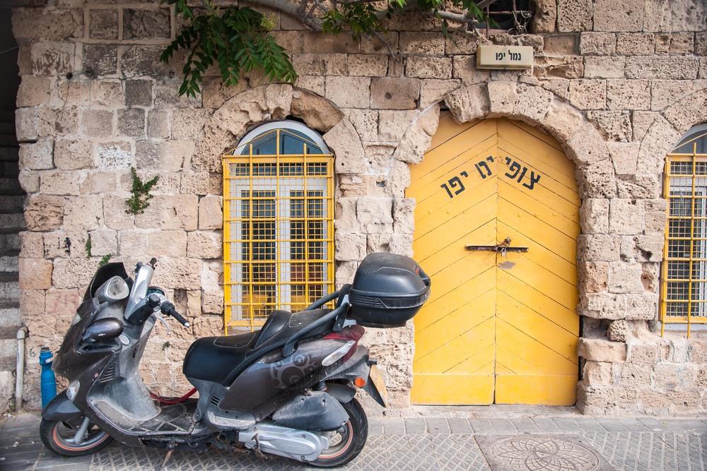 retsif-haaliya-hashniya-yellow-door-jaffa-israel_12490997424_o.jpg