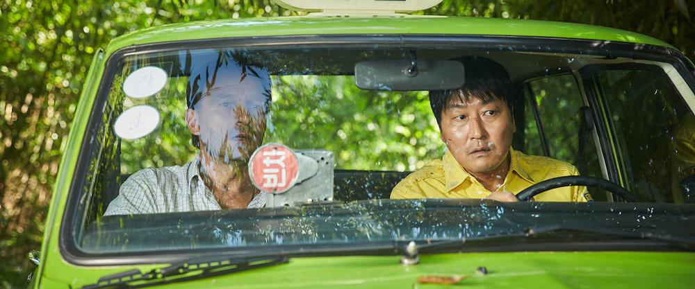 Song Kang Ho &Thomas Kretschmann in  A Taxi Driver  |Roger Ebert