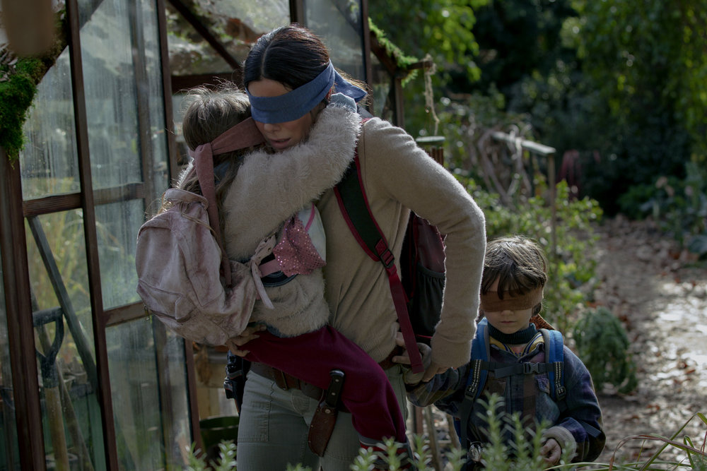 Sandra Bullock, Vivien Lyra Blair, and Julian Edwards in  Bird Box  | Collider