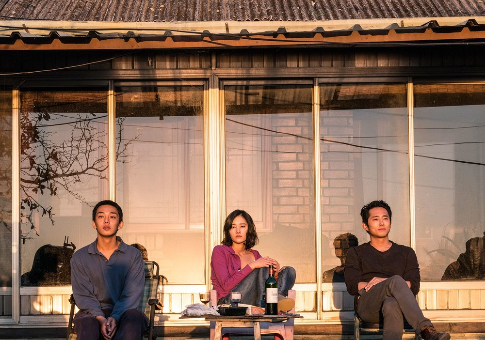 Yoo Ah In, Jeon Jong-Seo, and Steven Yeun in  Burning  | Vogue