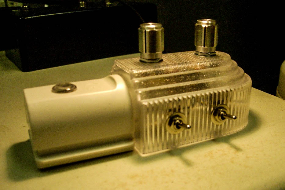 Opto-theremin oscillator built into a $1 store Nite Lite. View 1