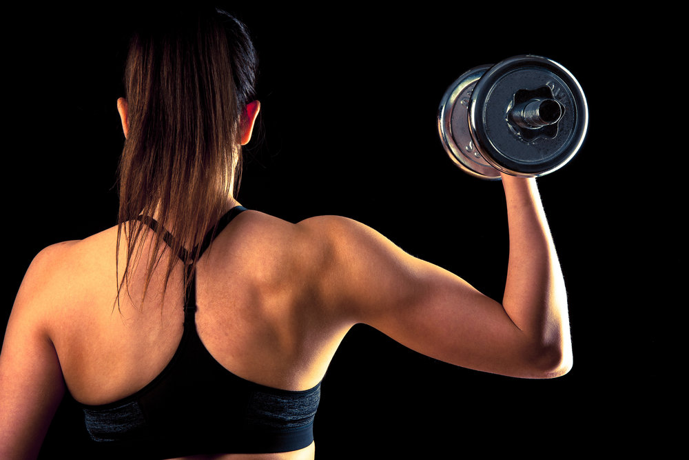 Copy of Fitness girl - attractive young woman working out with dumbbells