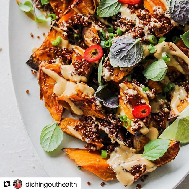 RECIPE 🍠❤️ Thanks! @dishingouthealth ・・・ Y'know what every roasted sweet potato needs? A big creamy hug from Asian peanut sauce. And a protein boost from quinoa never hurt. These spuds are hearty enough to stand alone, yet versatile enough to team up with any protein (I love serving them with ginger-soy glazed salmon). Recipe link in bio @dishingouthealth