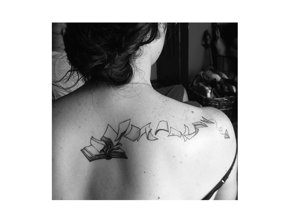 book back tattoo E.jpg