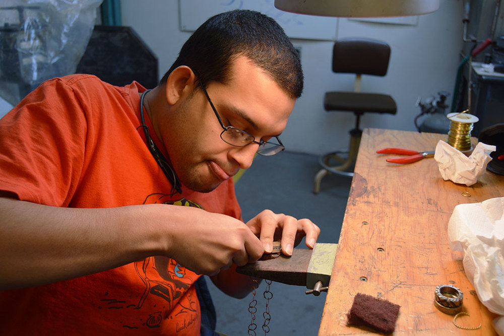 Felix making jewelry at the Steel Yard