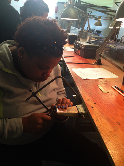 Luisa working on jewelry at the Steel Yard