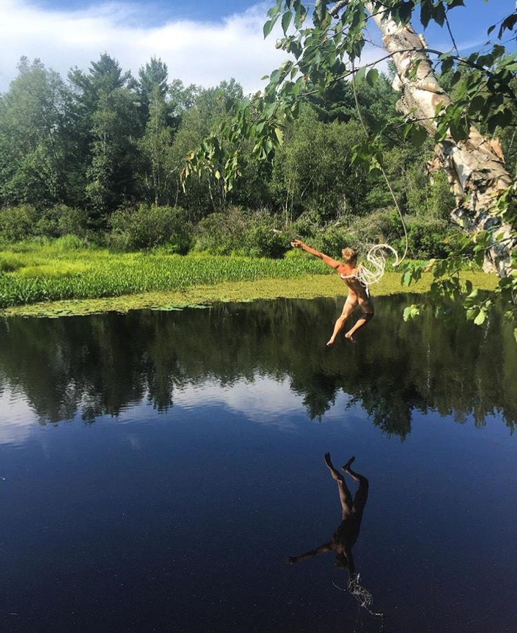 Cj leaping from the rope swing on our property into the west branch of the Narraguagus River.