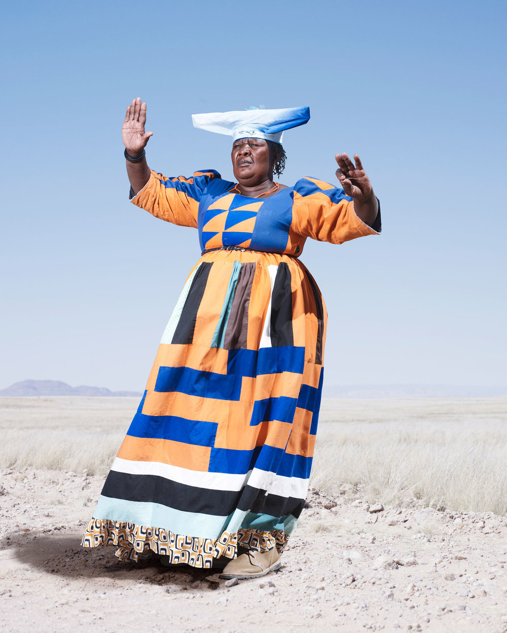Herero Woman In Orange Dress (2012)