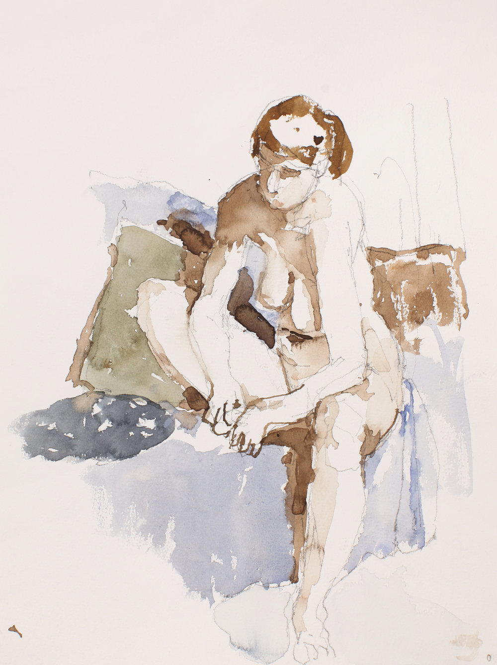 Nude Seated on Sofa with Pillows Holding Foot