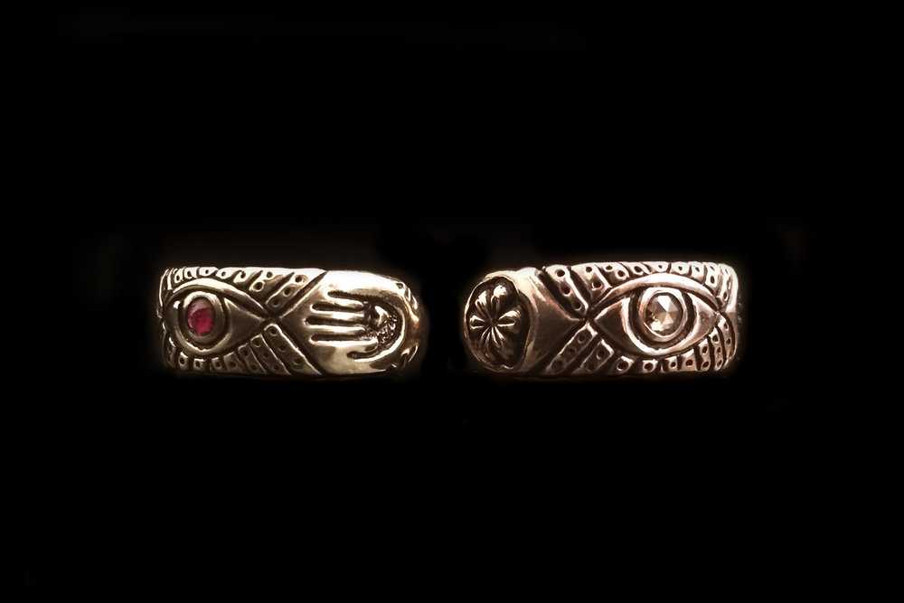 ruby eye gold ring and diamond eye rose ring.jpg