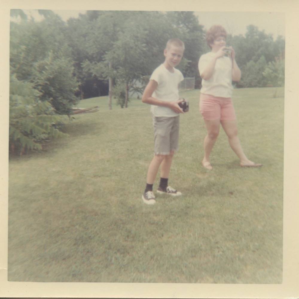 My dad holding the Brownie Hawkeye while one of my aunts takes a picture with the Instamatic.