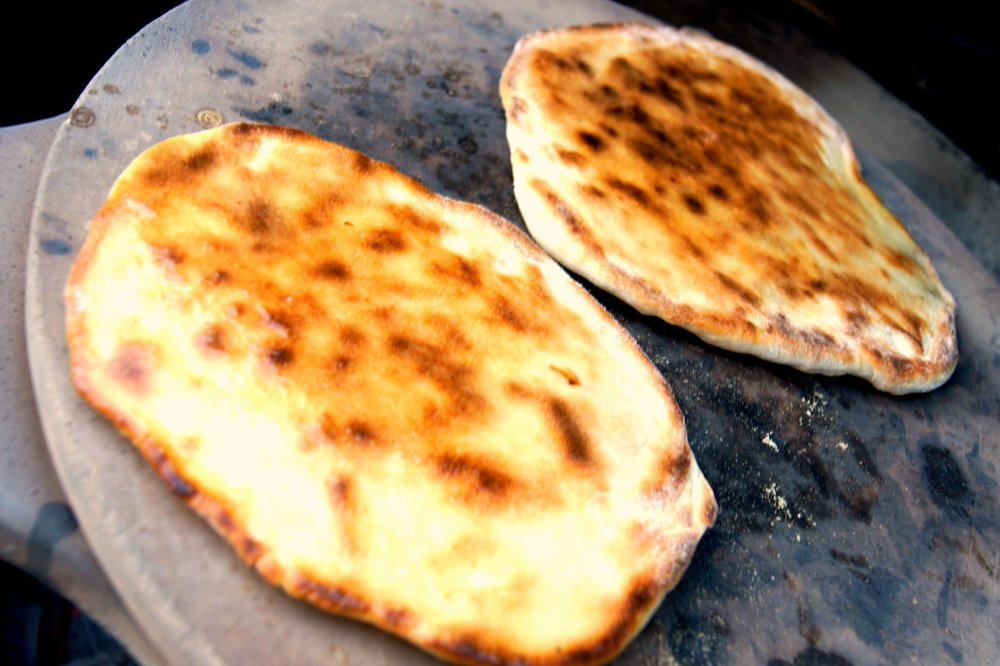 Baking naan in a Tandur oven.