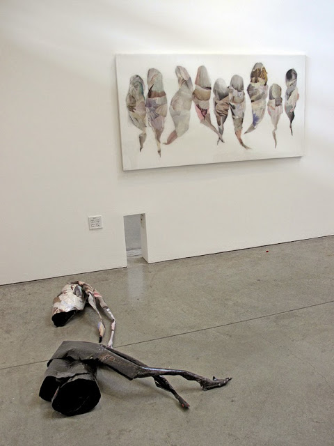 Phantom Limbs (floor pieces) , 2015, Hand-cut and assembled found images, aluminum. Approx. 3ft ft X 5ft X 1 1/2 ft each