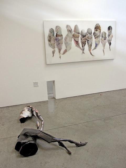 Phantom Limbs (floor pieces) , 2015,Hand-cut and assembled found images, aluminum.Approx. 3ft ft X 5ft X 1 1/2 ft each