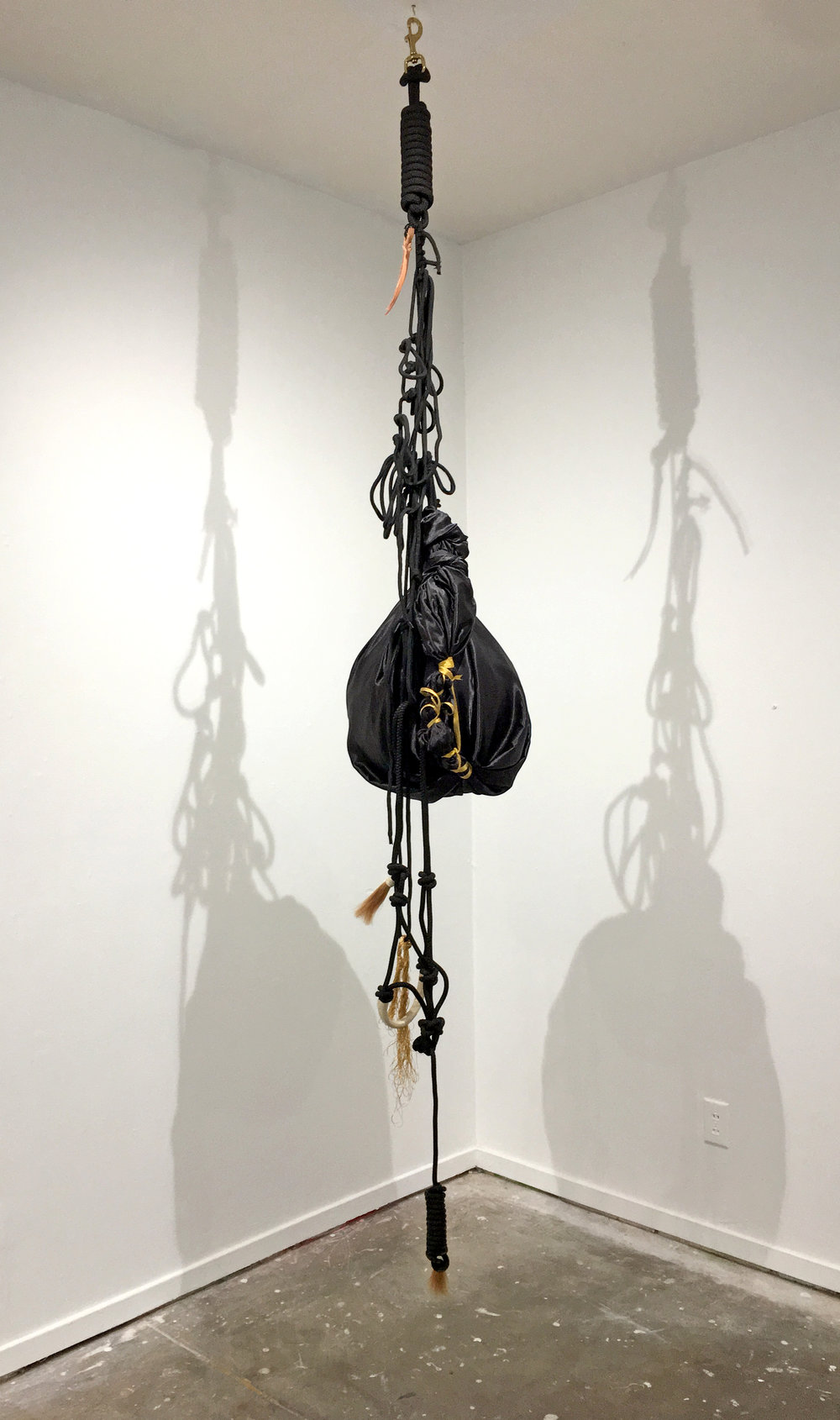Blue Black, Benighted,   2018, Satin, horse harness, ribbon, rope, beach ball, Dimensions variable
