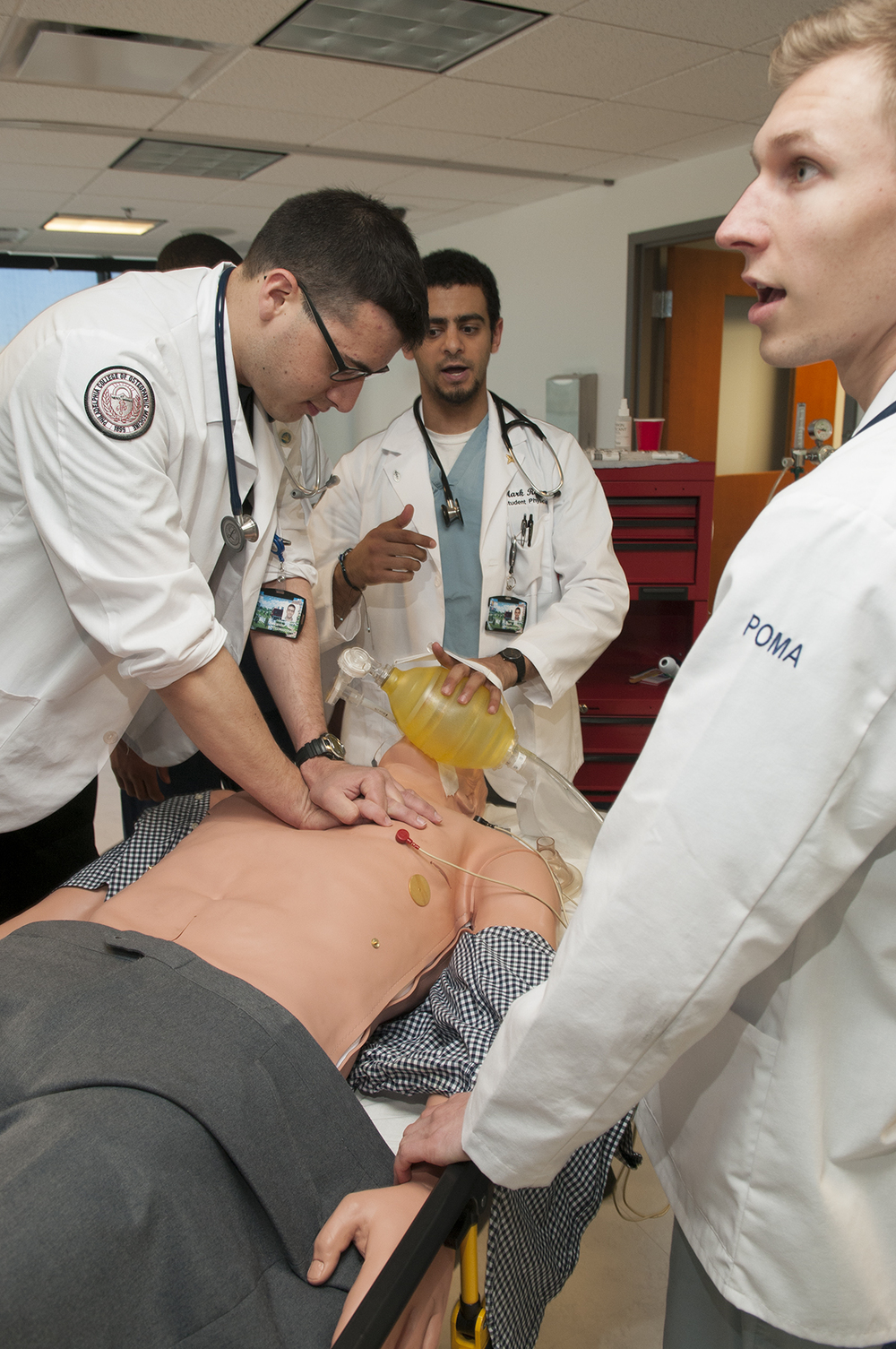 Sim Lab is dedicated to  translating preclinical knowledge into clinical acumen . Through the use of PCOM's CLAC on the 4th floor of Rowland Hall, the EMed Club is able to simulate emergency medicine cases with high fidelity. Sim lab is a very interactive experience and those who attend should expect to be brought into the process. The cases typically are designed to complement what is being learned in the classrooms of the 1st and 2nd year DO students, although  all PCOM students, regardless of program, year, or membership status in EMed Club are invited to attend . In other words, Sim Lab is about building a clinical knowledge base, learning how to think critically in front of a crashing patient and is open to everyone on campus!  For those who may be  interested in  submitting cases for sim lab , if you write a case it will be reviewed by current 3rd and 4th year students as well as EM residents and if accepted, you will be noted as a contributing author to the site. ( Yes, you can put this on your resume! )