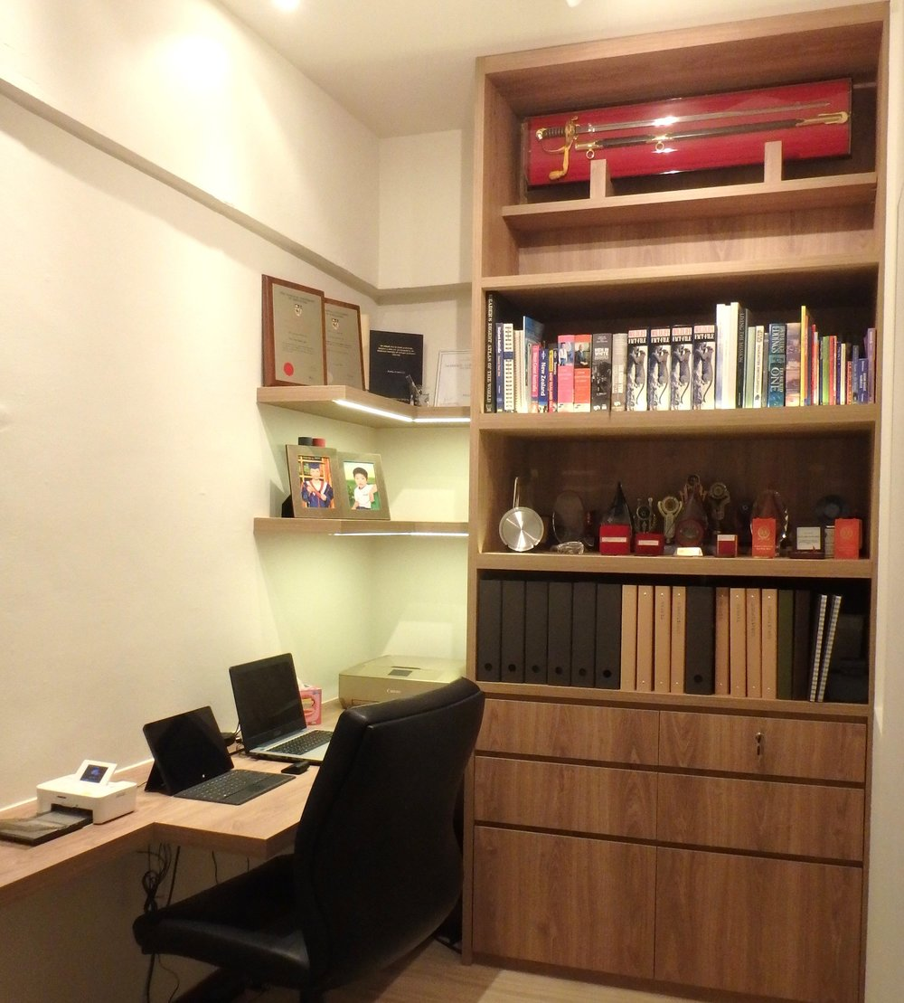 Clever space planning to convert the small utilities room into a Study with sufficient space for a desktop, printer, display shelves and books of higher learning for the two doctors.